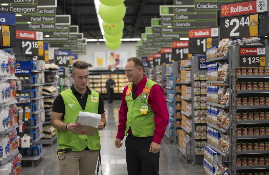 Neighborhood Market associates in aisle together