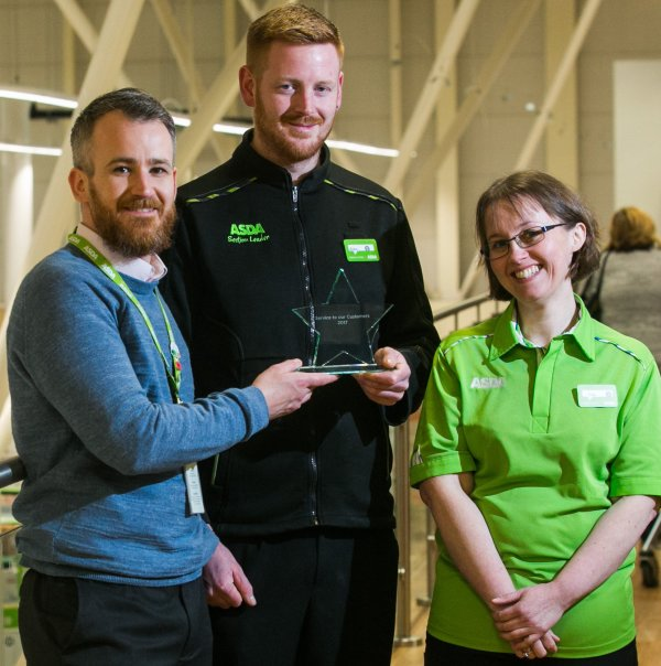 Aston celebrates his colleague of the year award win with colleagues at Asda Falmouth