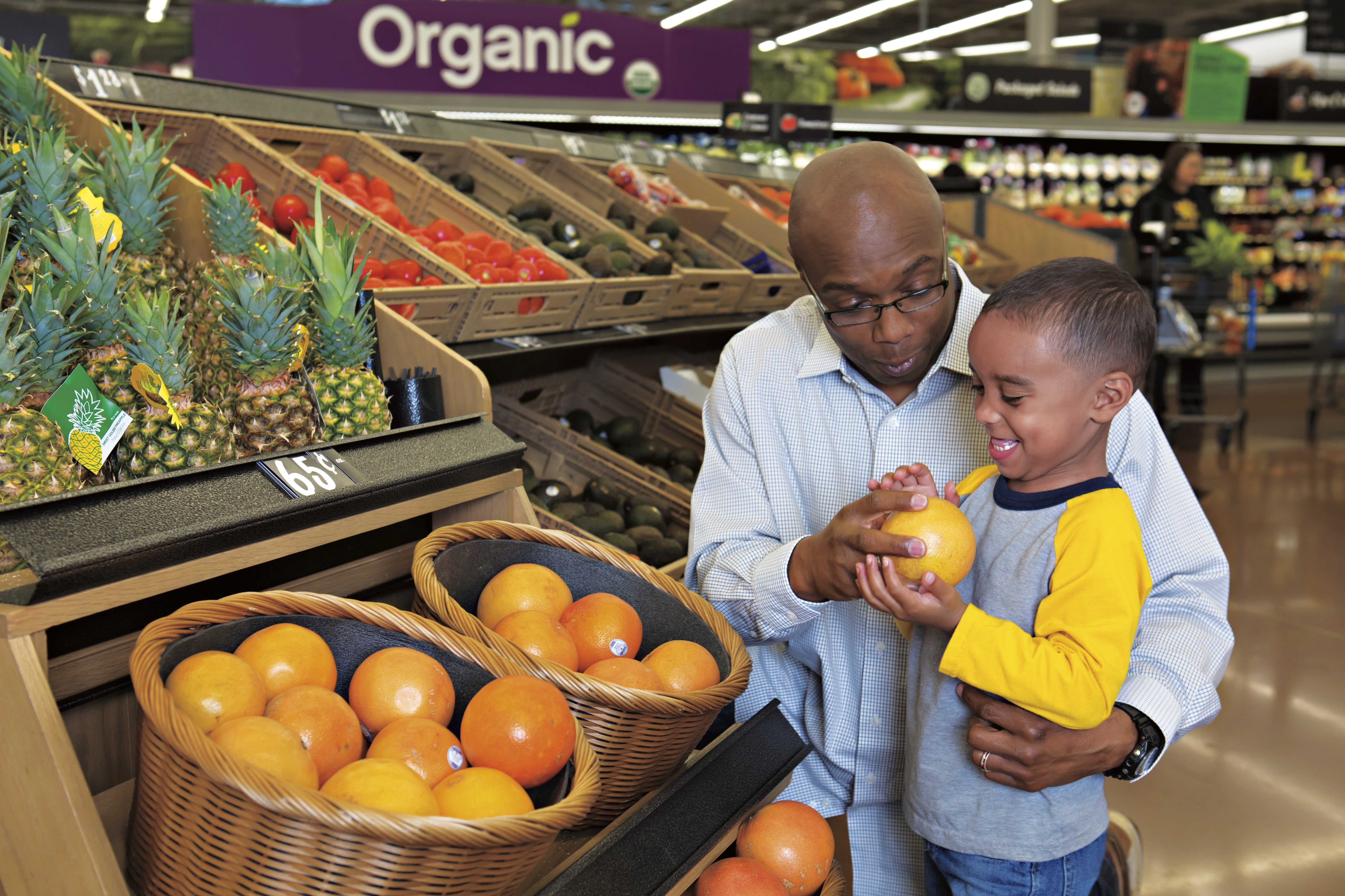 Father and son shopping in the produce section
