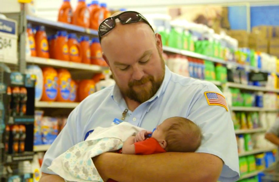 Baby Luke, born during Hurricane Michael, is held by a Walmart truck driver