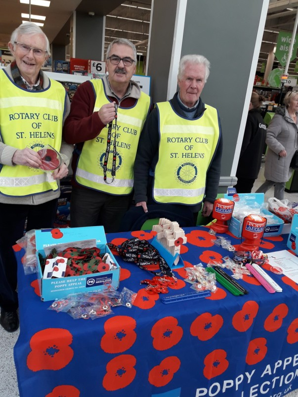 St Helens Rotary members sell poppies at Asda St Helens