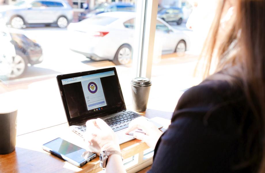 Associate studing on laptop with LBU platform