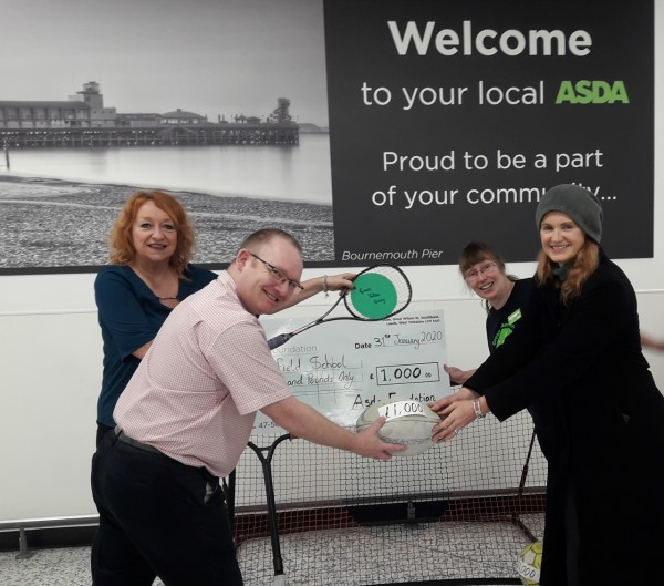 Sara and Angela from Autism Wessex who won £1,000 in the Asda Bournemouth green token giving scheme