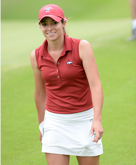 Gaby Lopez smiles on a golf course during the LPGA Tour in Rogers, Arkansas