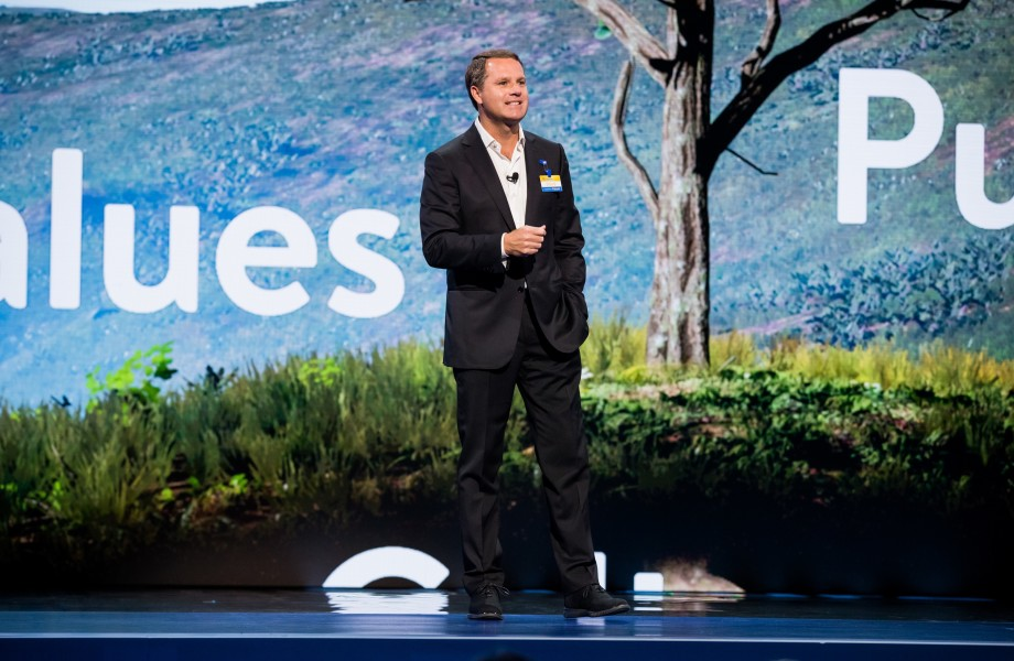 Doug McMillon, President and CEO of Walmart, speaks in front of tree at Walmart Associate Meeting during Shareholders 2018