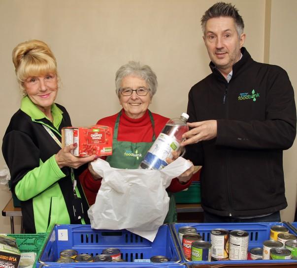 Asda Leigh community champion Gwen with foodbank volunteers