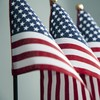 Four American flags wave