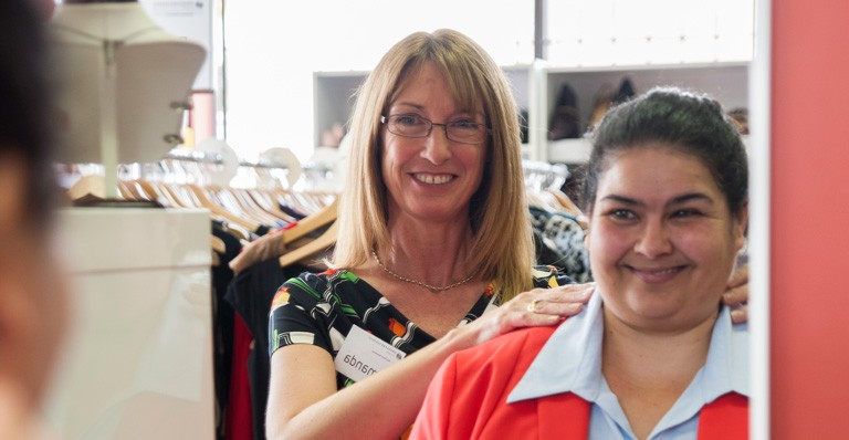 Dress For Success Volunteer Helping Client