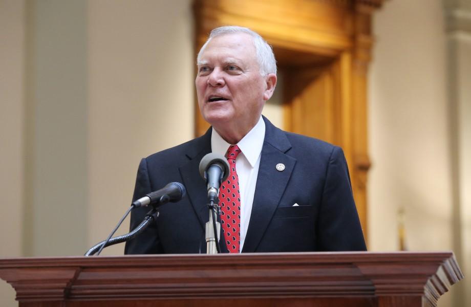 Georgia Gov. Nathan Deal stands at wooden desk speaking