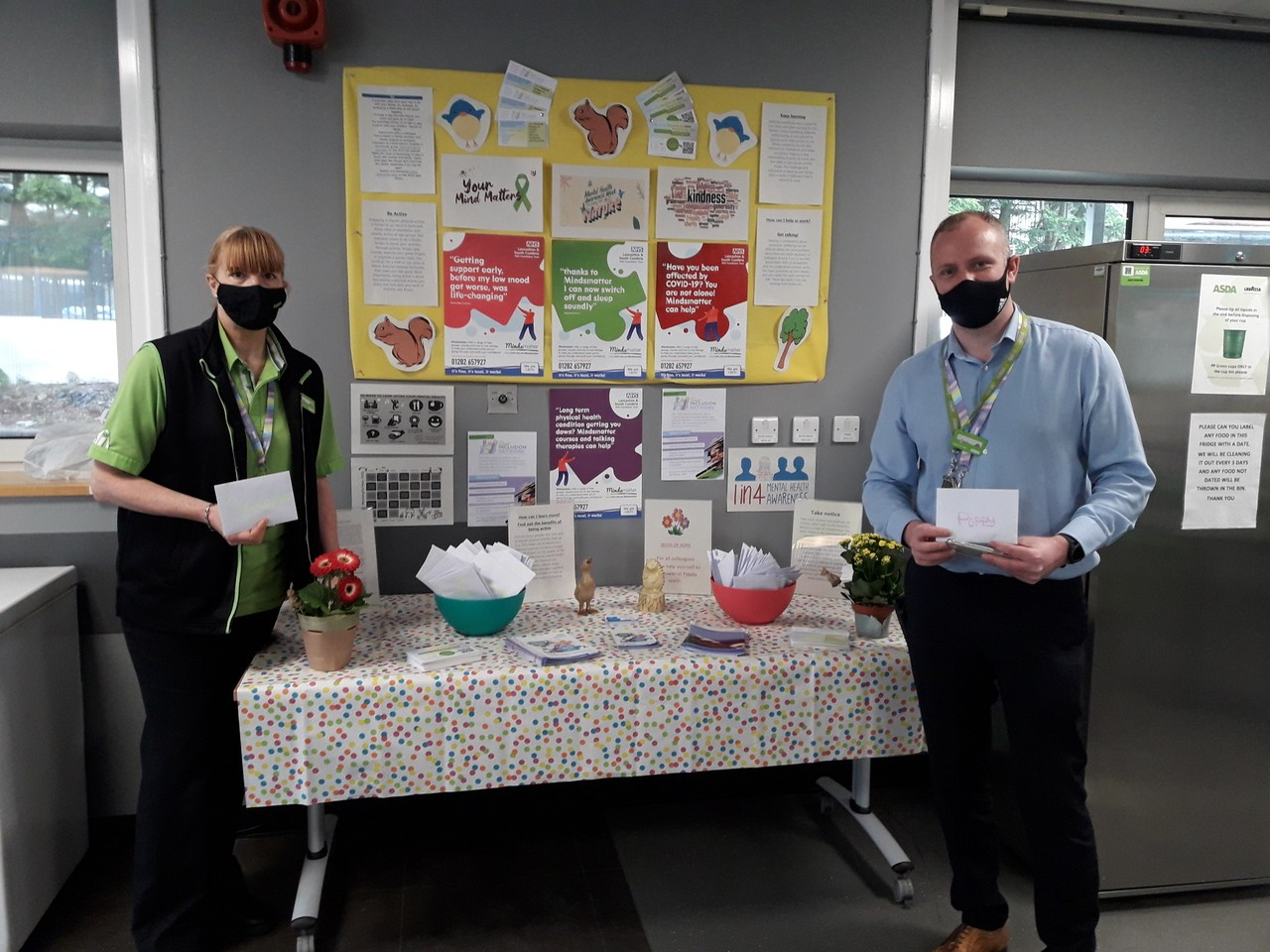 To support mental health week we have put up an advise area and given free poppy and sunflower seeds to every colleague | Asda Colne