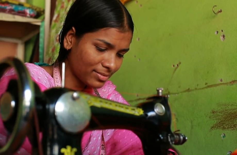 Bangladeshi garment worker Ankhi at sewing machine