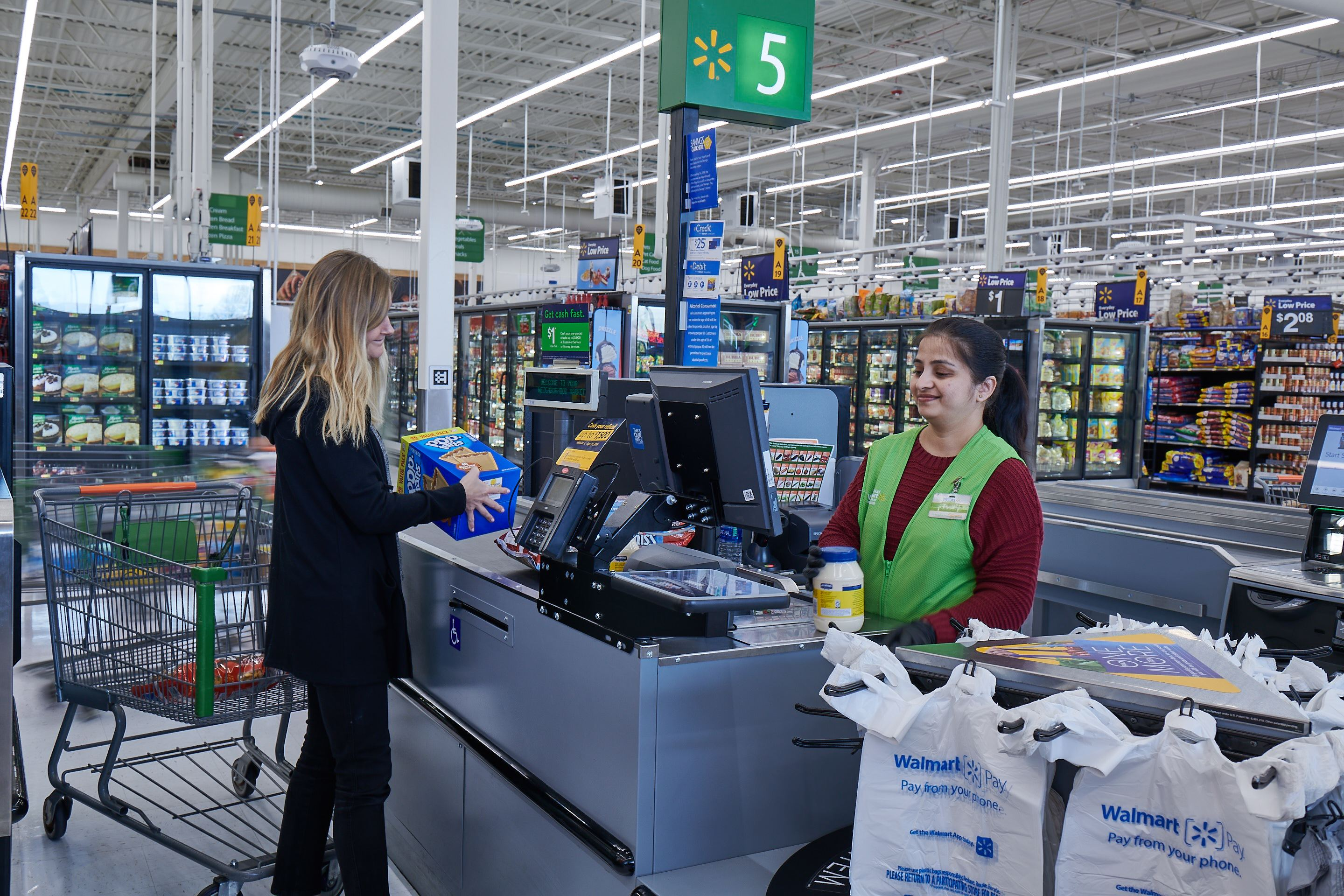 Customer checking out with associate at IRL Walmart