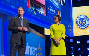 Roz Brewer and Neil Ashe on stage presenting during the 2016 Shareholders Meeting