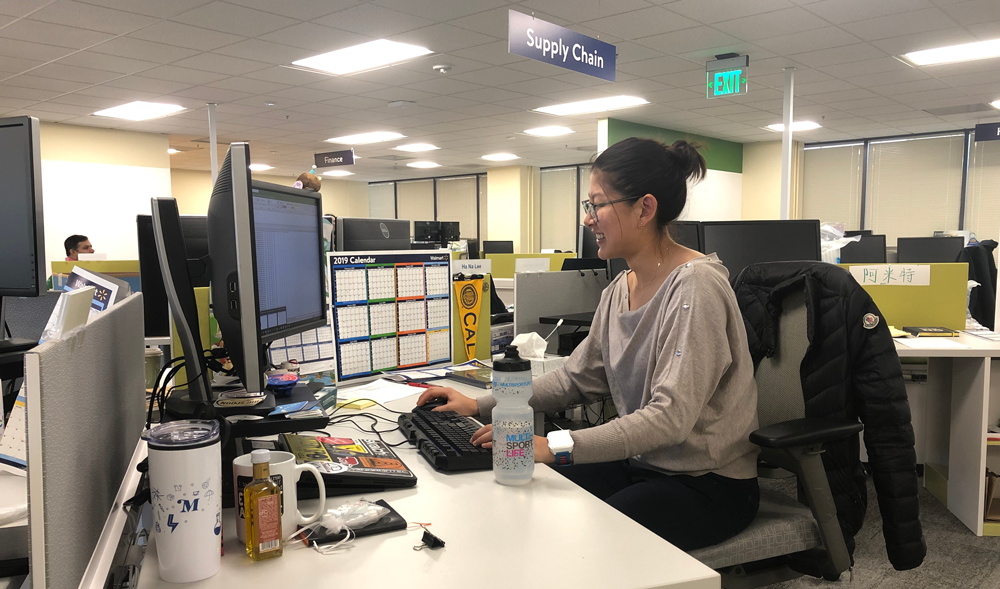 Ha Na Lee sits at her desk in Walmart's San Bruno, California office