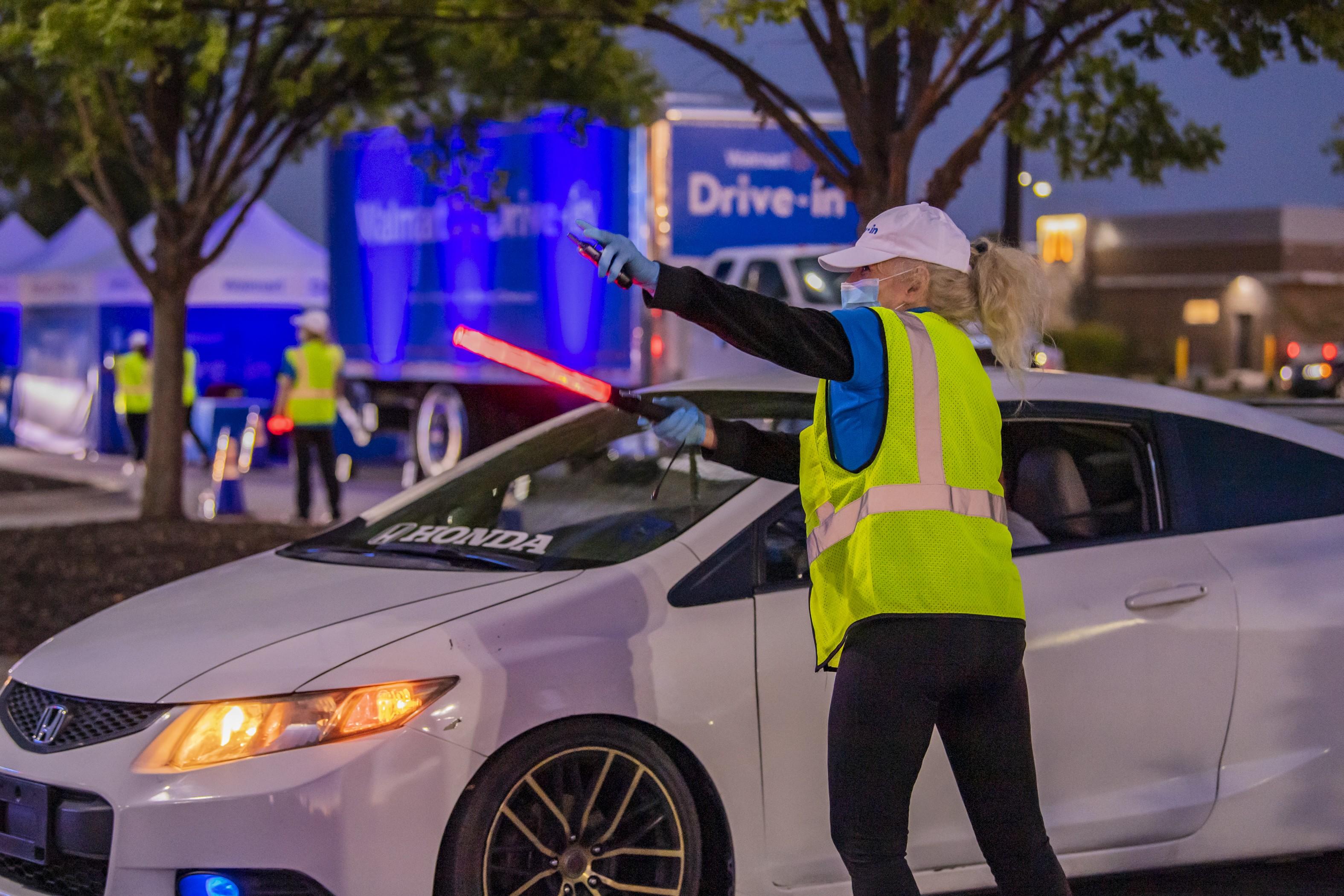 Walmart Drive-In associate directing traffic