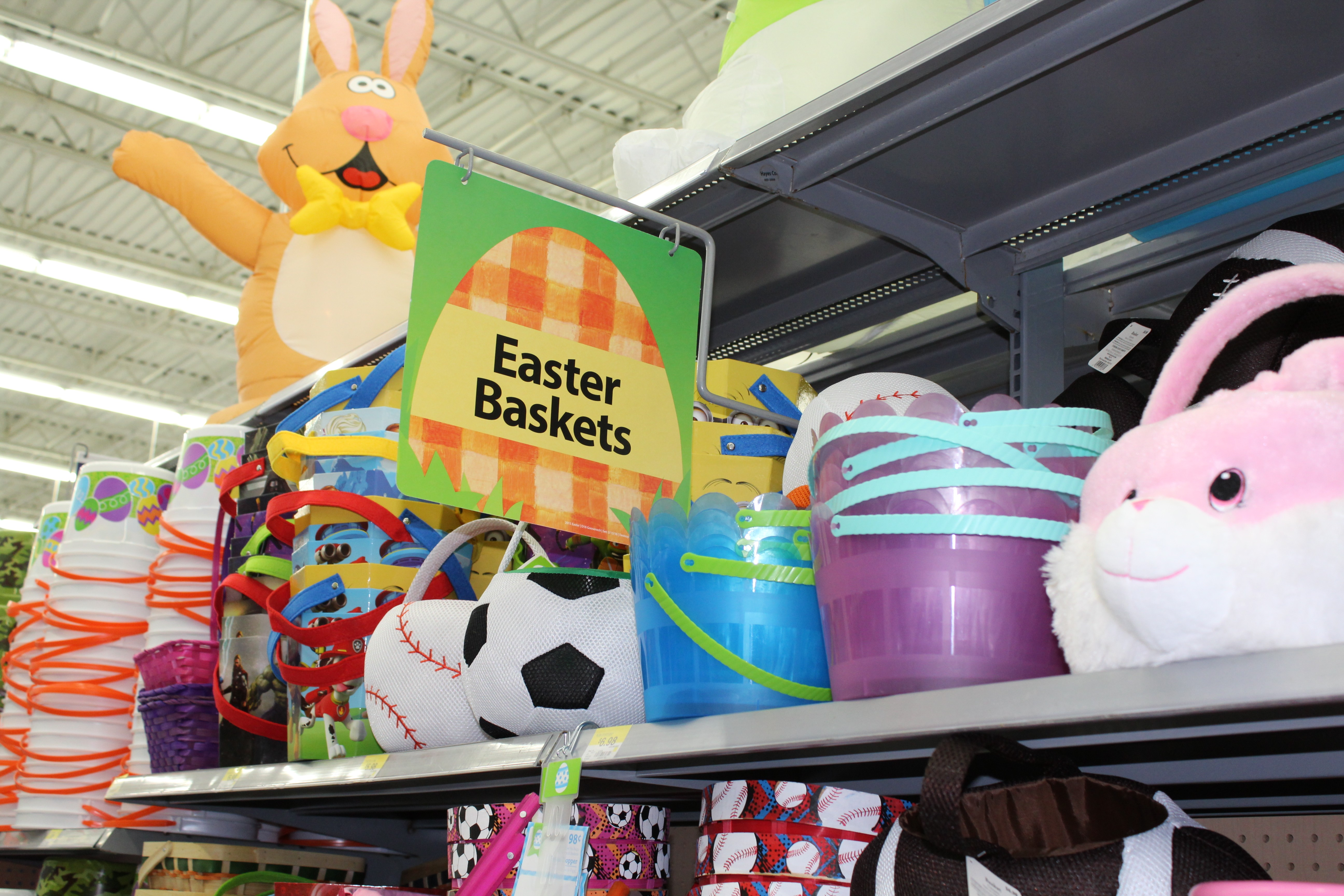 Easter baskets line a shelf in a Walmart store