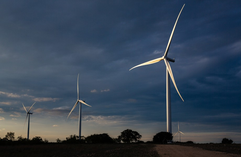 Wind Turbines Against Darkening Sky