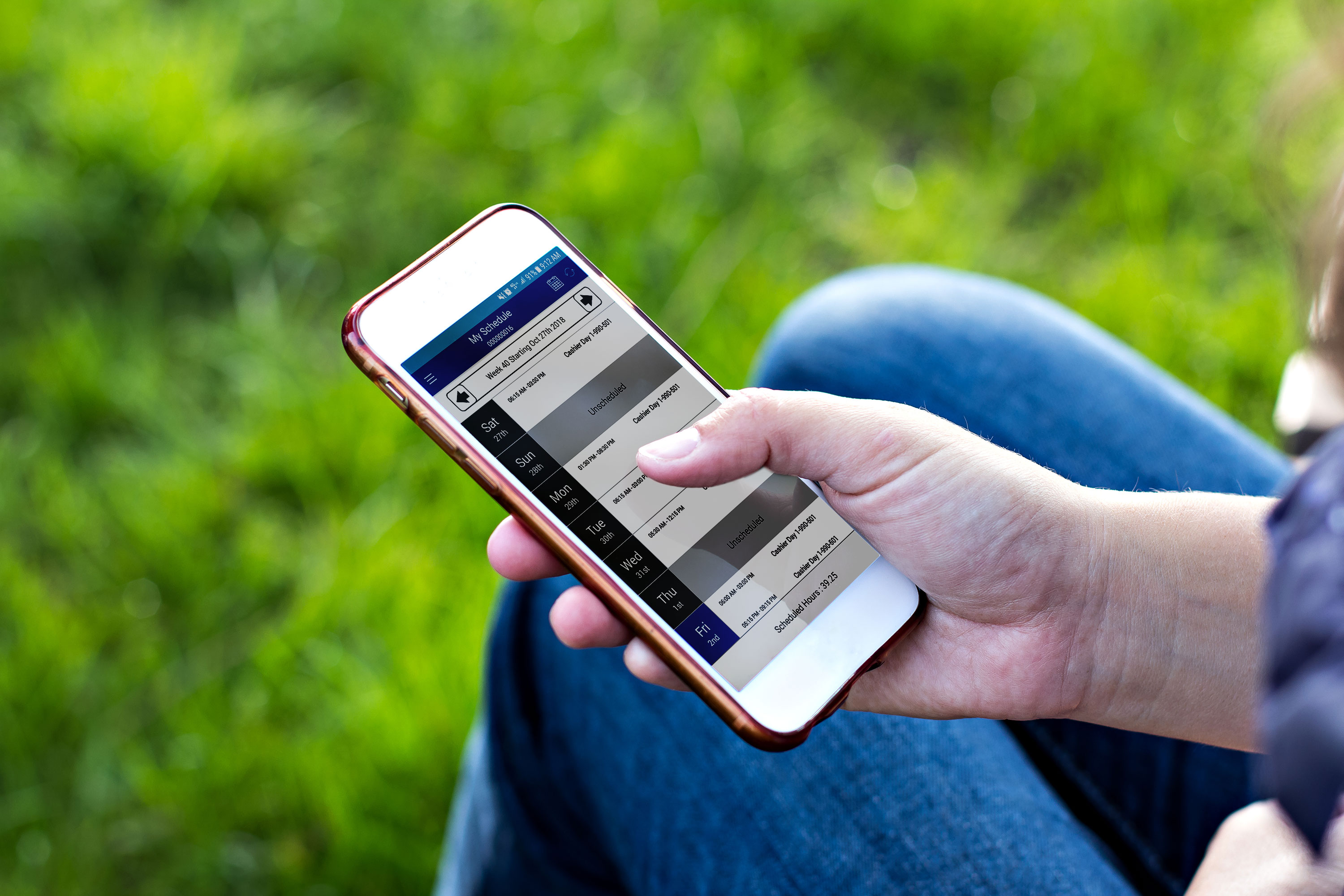 An associate checks the My Walmart Schedule app from their smartphone