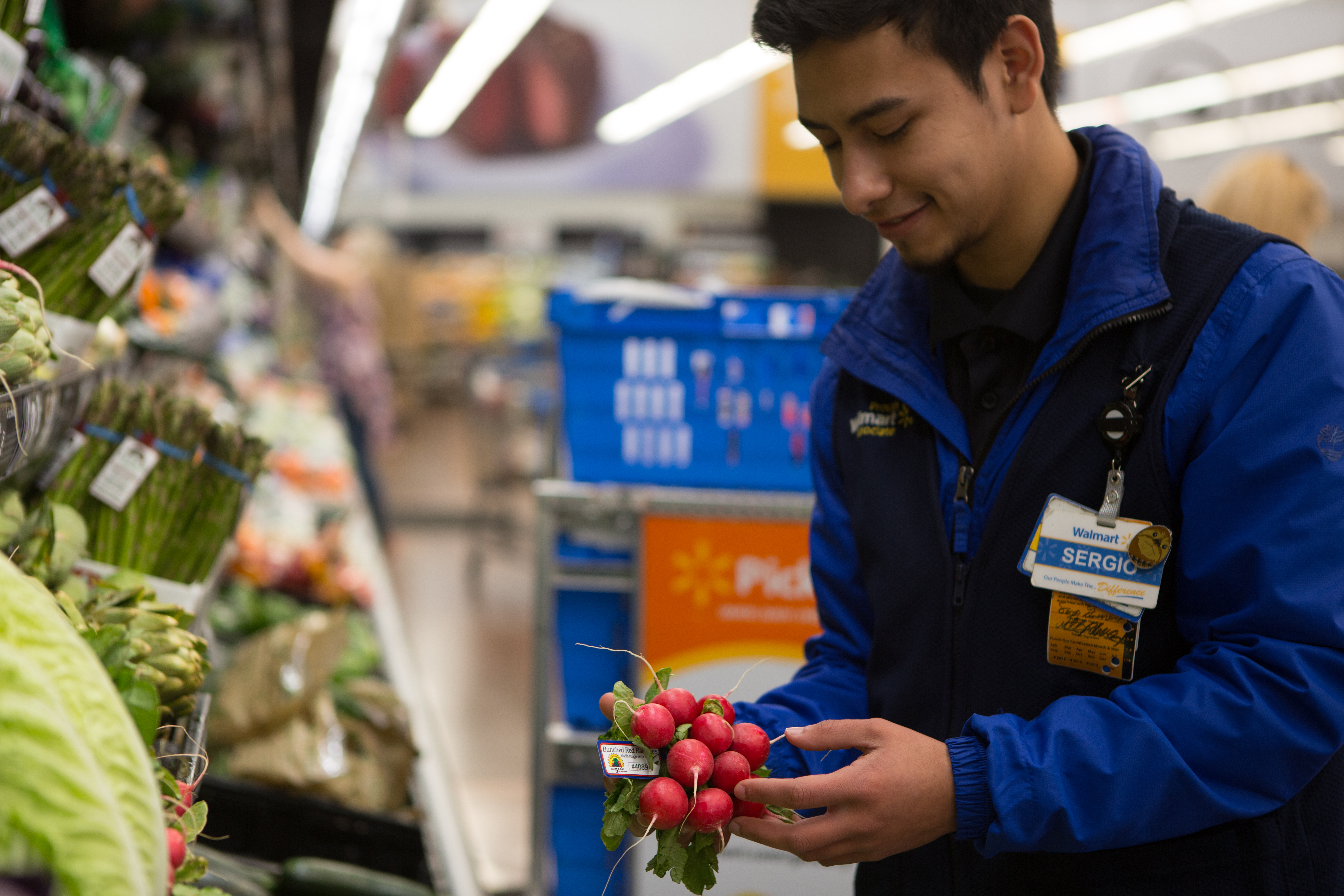 Walmart personal shopper selects radishes